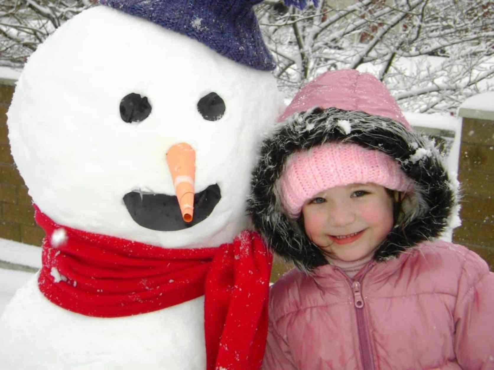 mackenzie with snowman