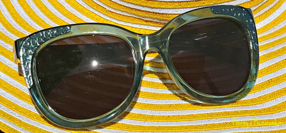 ottica coach prescription sunscreen resting on yellow sun hat