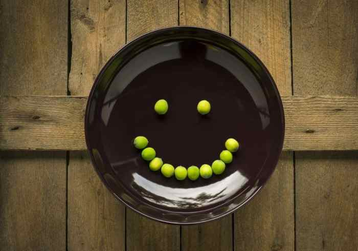 peas forming smiling face on plate