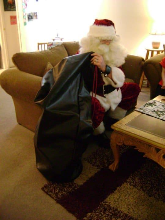 santa-claus-with-big-black-bag