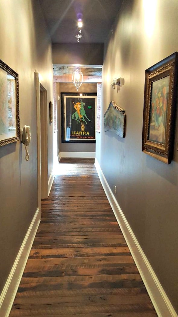 windsor boutique hotel hallway with izarra poster