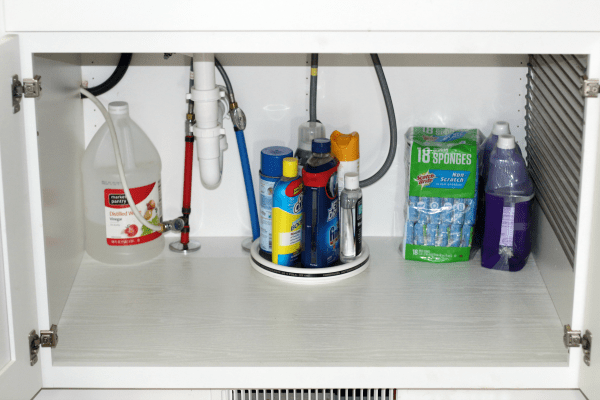 how to organize under the kitchen sink infrequently used in back