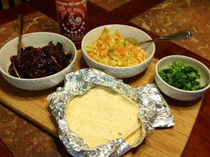 serve with slaw, warmed tortillas, cilantro and sirarcha