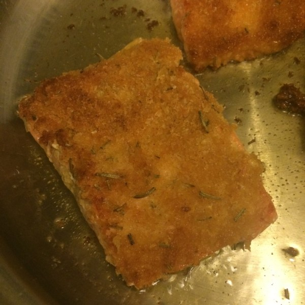 Place salmon filets bread crumb side down in