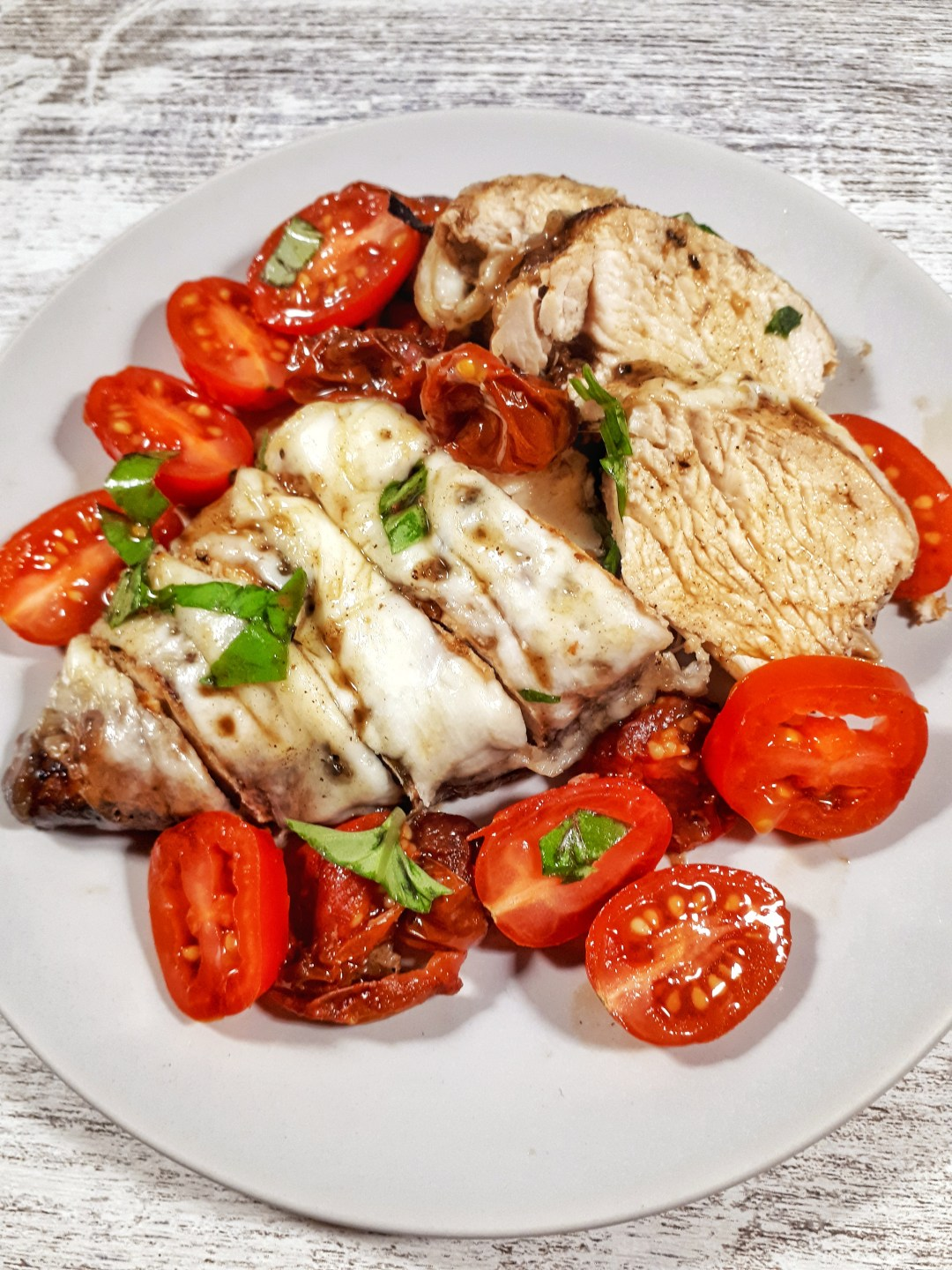 Oven Baked Chicken Breast with fresh mozzarella and cherry tomatoes is healthy, keto, simple, flavorful, and so tender…this is a great weeknight dinner recipe.