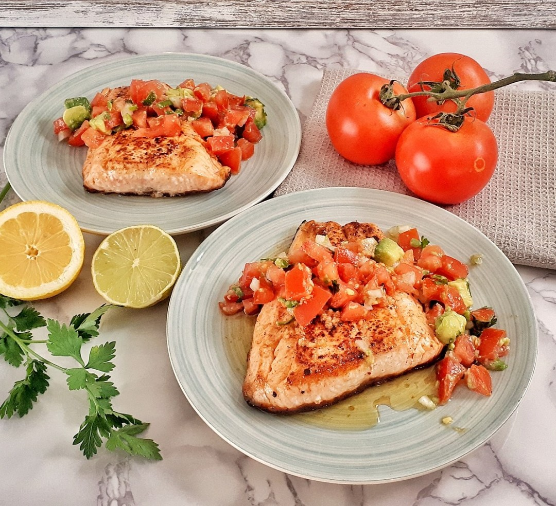 Keto salmon fillets are pan-seared are a healthy and simple dinner with a vibrant and rich lime tomato and avocado salsa. Simply irresistible! #ketomeal #ketodinner