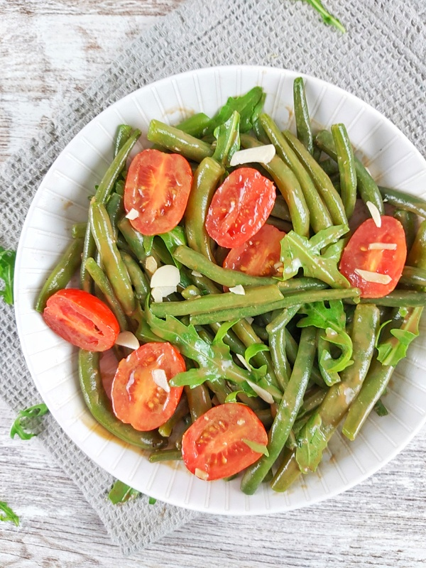 This Green Bean and tomato salad is fresh, crisp, and bursting with flavor! Is a summer treat that's low-carb, gluten-free, and vegan!