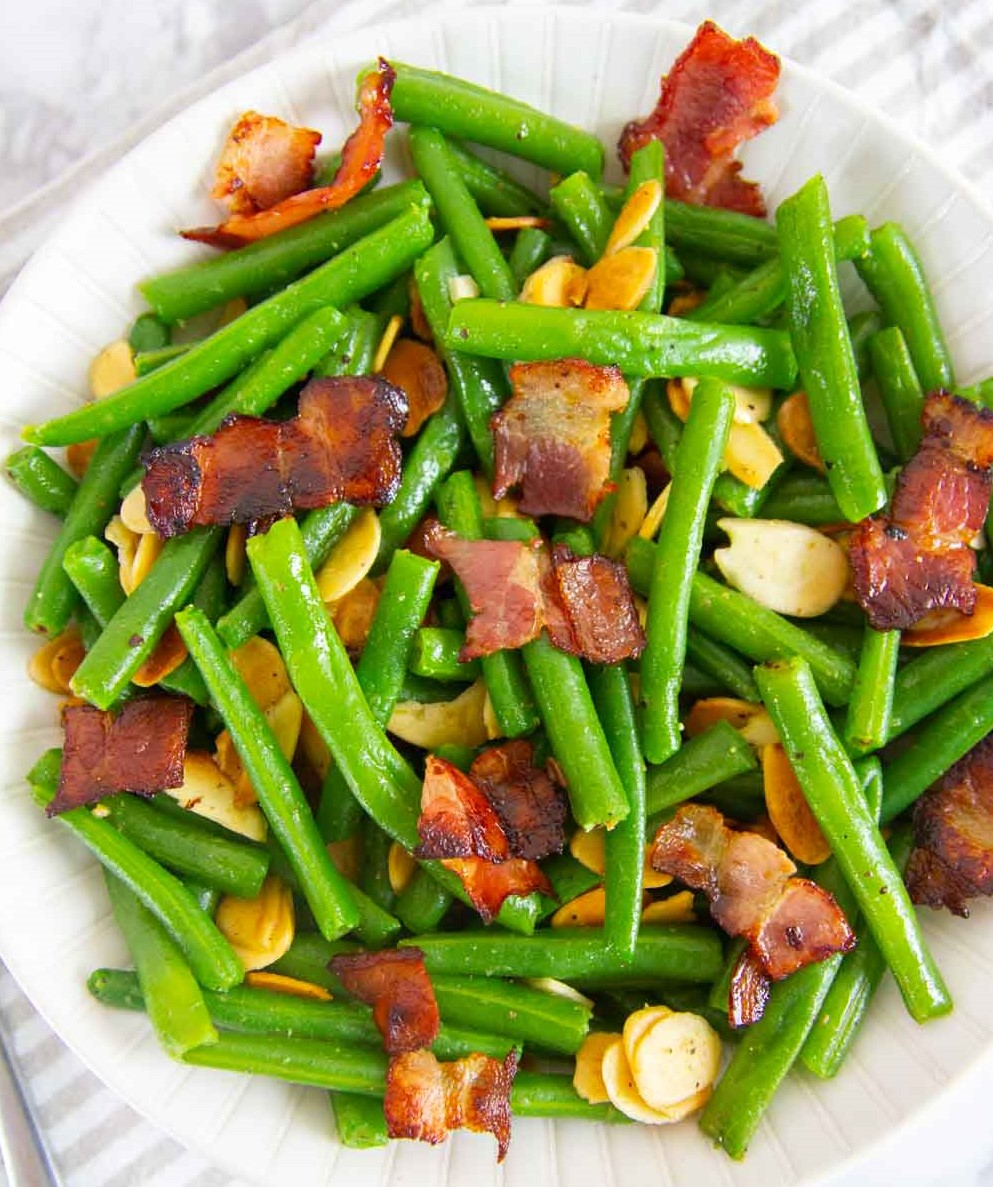 This easy green beans with bacon and almonds side dish makes an elegant side dish that's perfect for a holiday meal or an easy weeknight dinner.