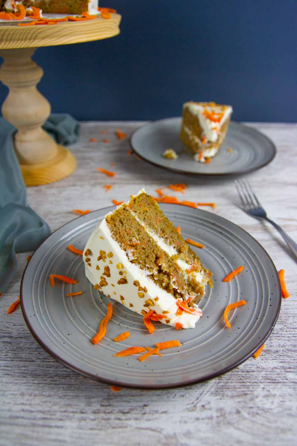Keto Carrot Cake with Cream Cheese Frosting is perfectly moist and delicious, made with lots of fresh carrots, and topped with the most heavenly cream cheese frosting. #easter #easterrecipes #carrotcake #ketodessert #ketocake #lowcarb