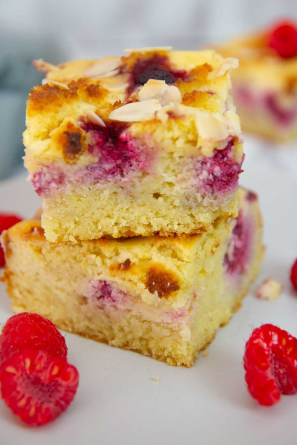 This keto raspberry coffee cake is soft and moist with juicy raspberries and cream cheese filling and a buttery almond streusel on top. #keto #ketorecipes #lowcarb #raspberry #coffeecake