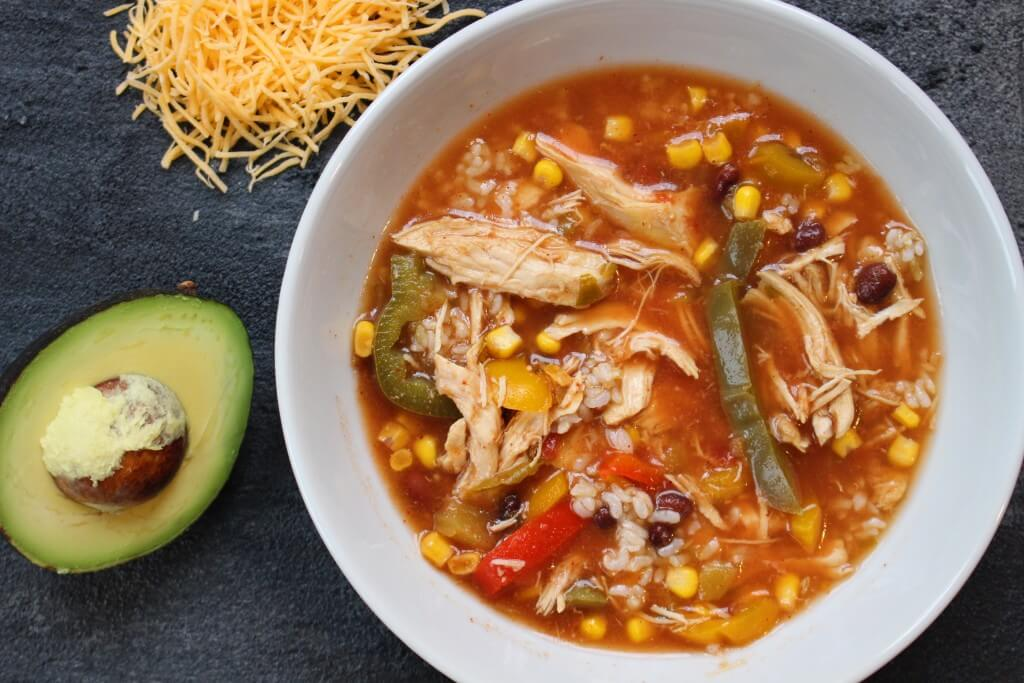 Slow cooker chicken tortilla soup is an easy to make one-pot meal filled with simple and flavorful ingredients!