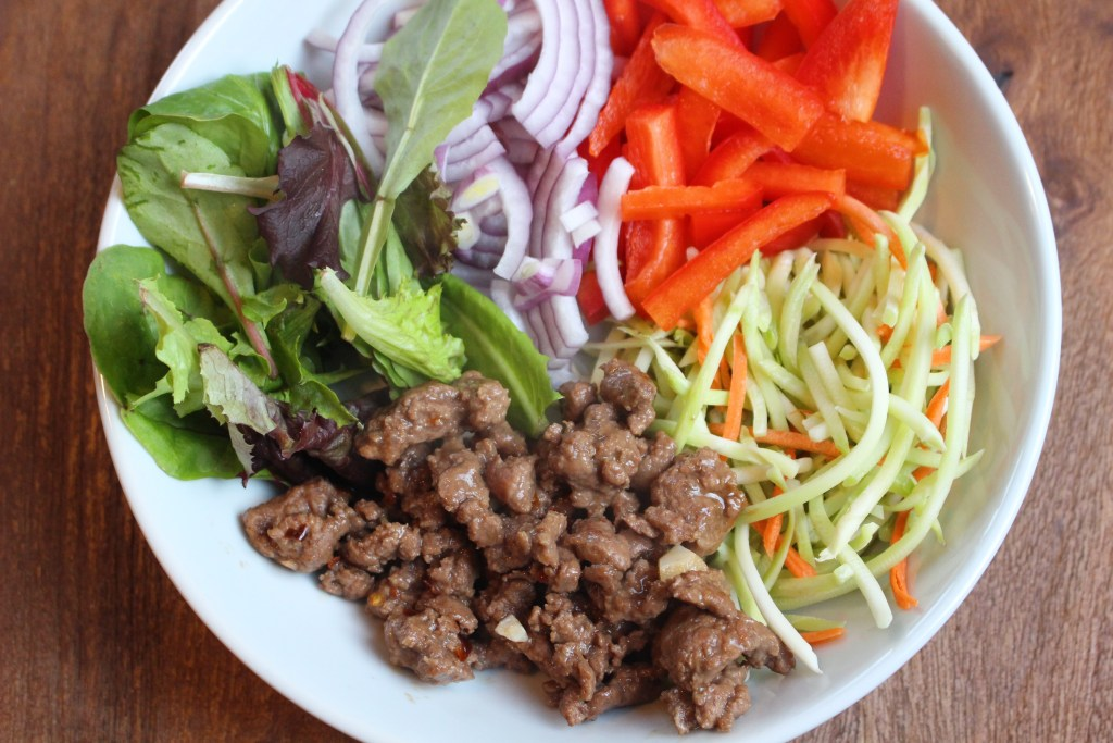 Thai Beef Salad pairs a spicy peanut sauce with fresh veggies and lean ground beef to make on easy weeknight meal