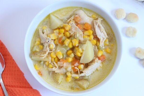 Frozen corn meets creamy cheddar cheese to bring you dinner in no time with this Cheesy Chicken Chowder.