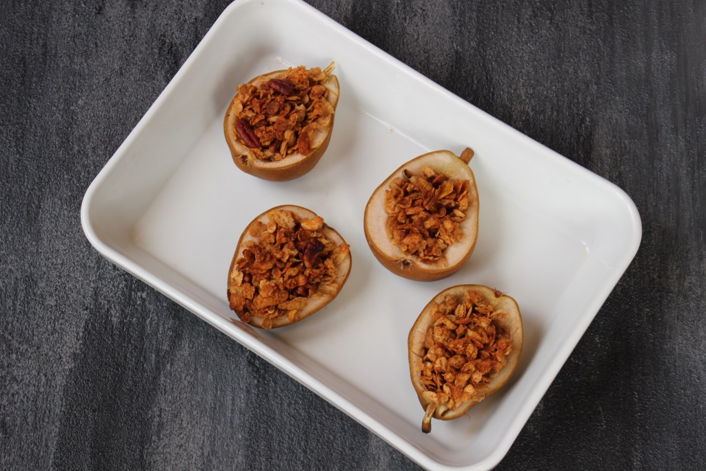 Baked pears with crunchy topping is a mix of great flavors and textures: pears are baked with a whole grain cereal filling and topped off with yogurt.