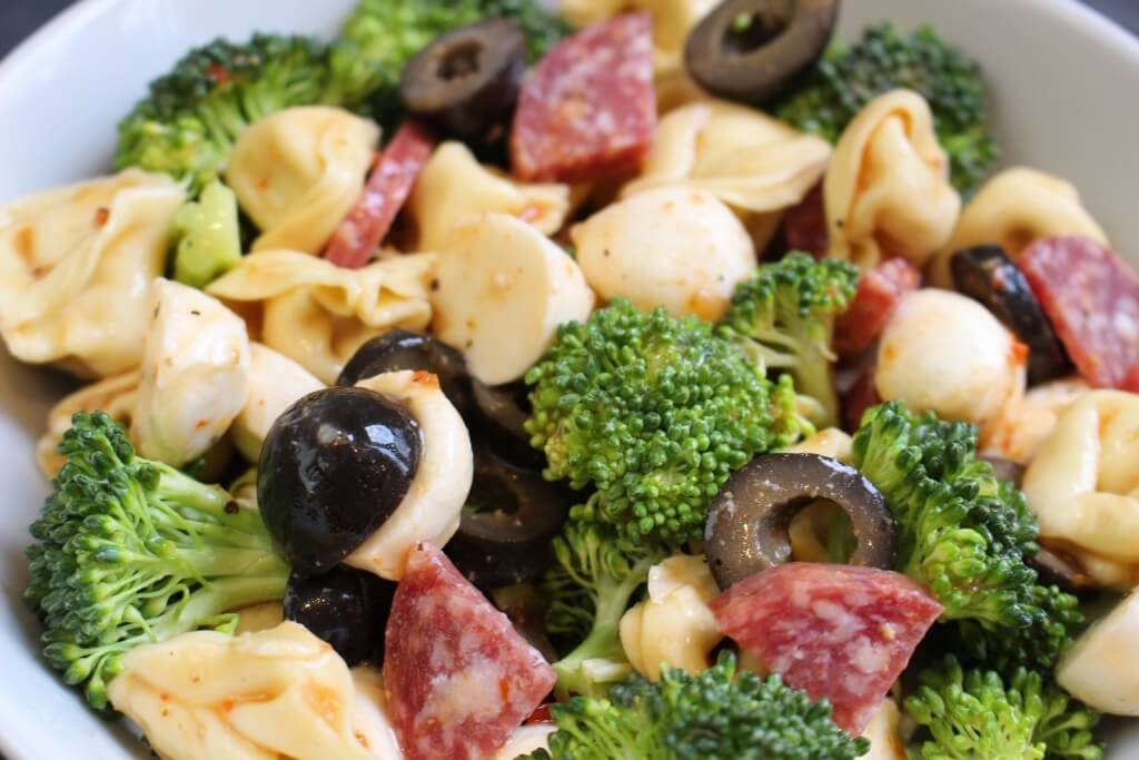 A quick and flavorful Italian pasta salad with fresh veggies, kid-friendly cheese tortellini, and prepared Italian dressing.