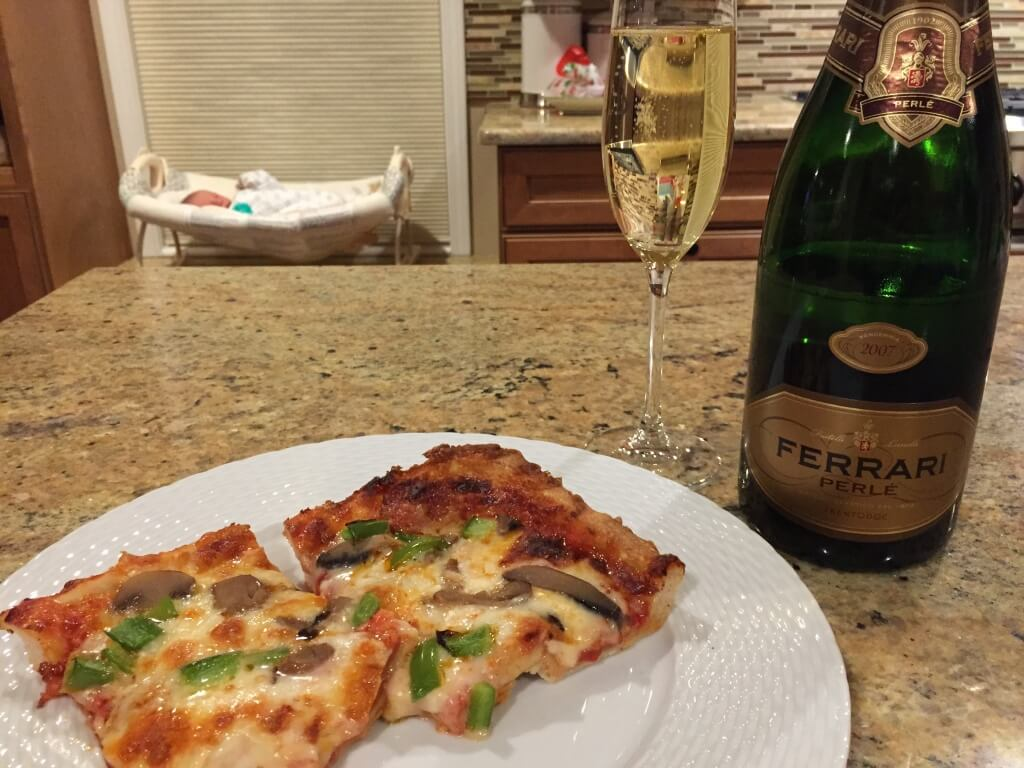 Our post-baby meal: Pizza! Or so that's what it's been with the boys. We shall see what little sis feels like [I'm sure the champagne will stay the same].