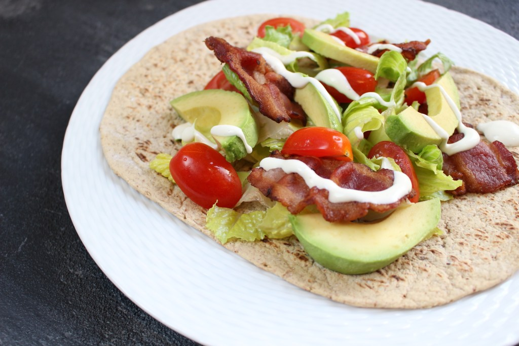 What could be better than a simple bacon, lettuce, tomato, and avocado wrap [BLTA wrap]?! Layered in a Flatout Flatbread this sandwich makes for the easiest lunch!