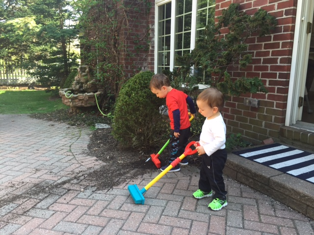 Give them matching brooms and they take interest in cleaning too. Who would've guessed it?!