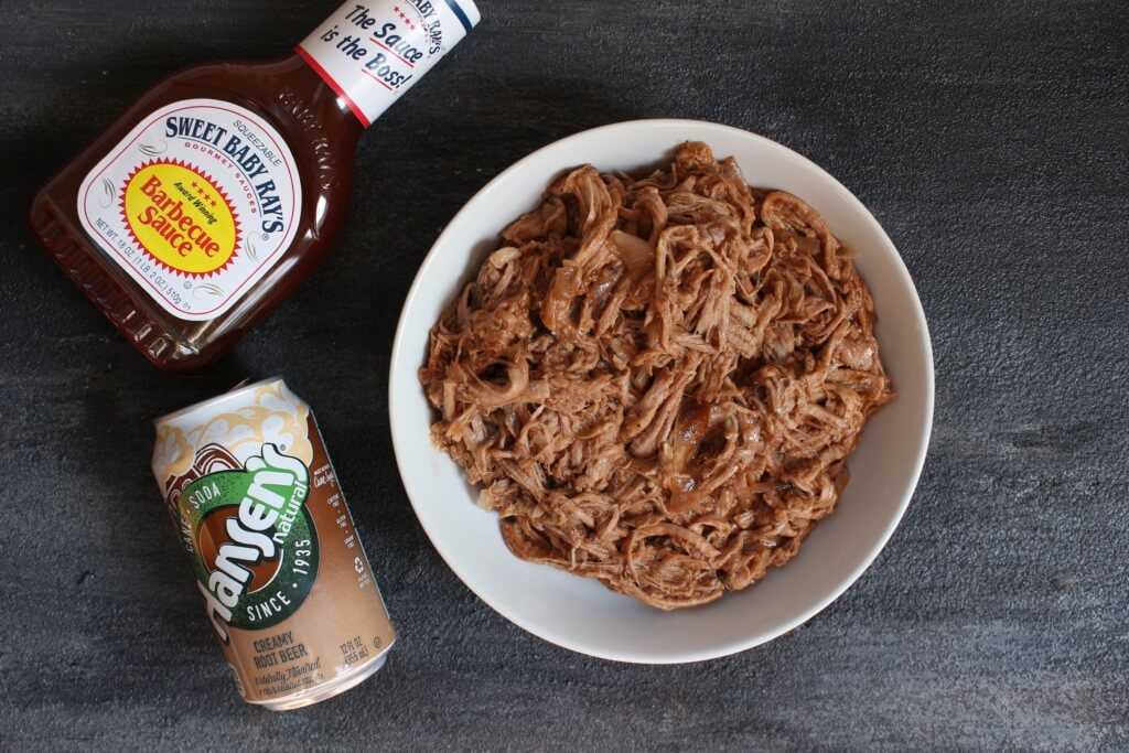 Pork tenderloin simmered in root beer and finished with BBQ sauce makes one simple, unique take on pulled pork sandwiches!