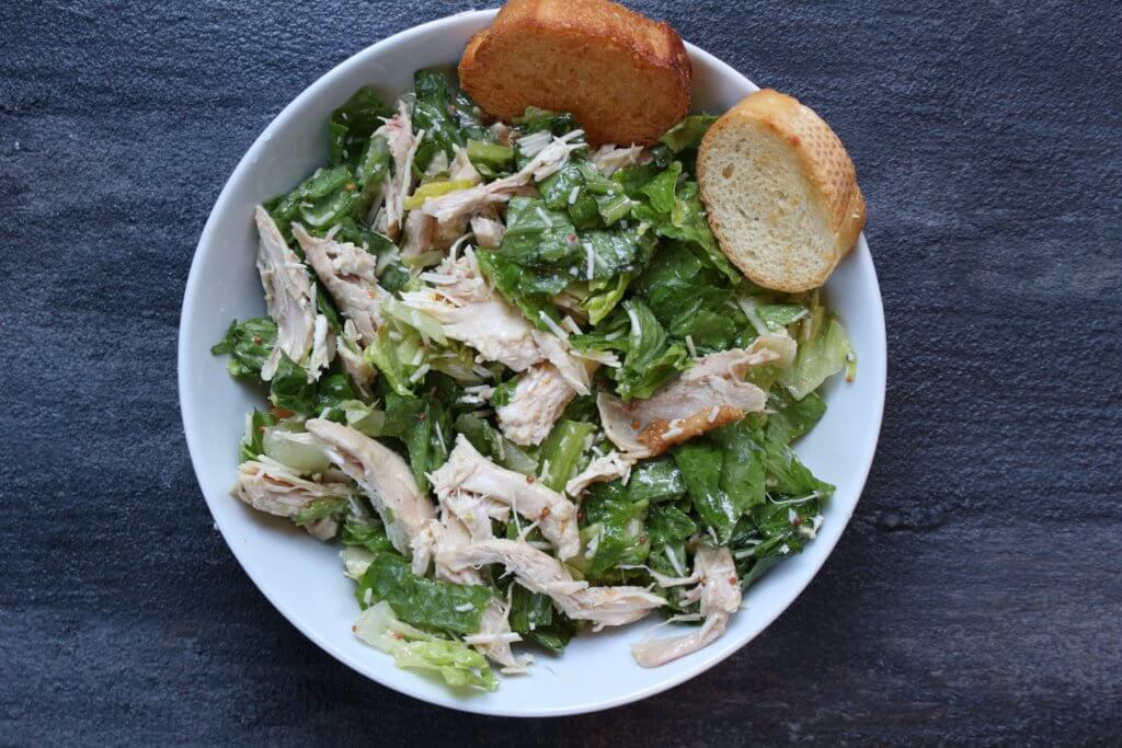 Rotisserie Chicken Caesar Salad is made by a pre-cooked rotisserie chicken, making dinner extra easy and fast! Plus this recipe comes with a simple, homemade Caesar salad dressing.