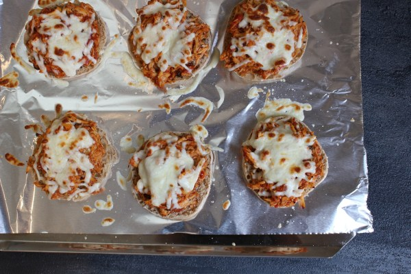 Chicken Parmesan Melts are a tasty version of the classic Italian dish. A delicious sandwich baked to perfection with melted mozzarella cheese on top!