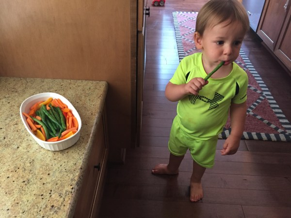 And when snack time seems never ending, use it to your advantage to get more fruits and veggies in your child's diet, by only offering those things before a meal! Can you tell he's thrilled to be eating a cold green bean?!