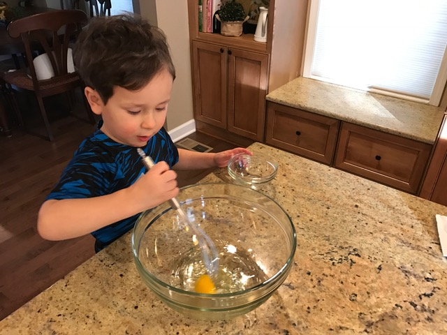 From unloading groceries, washing produce or grating cheese, here are 8 fun and interactive ways toddlers can help in the kitchen.