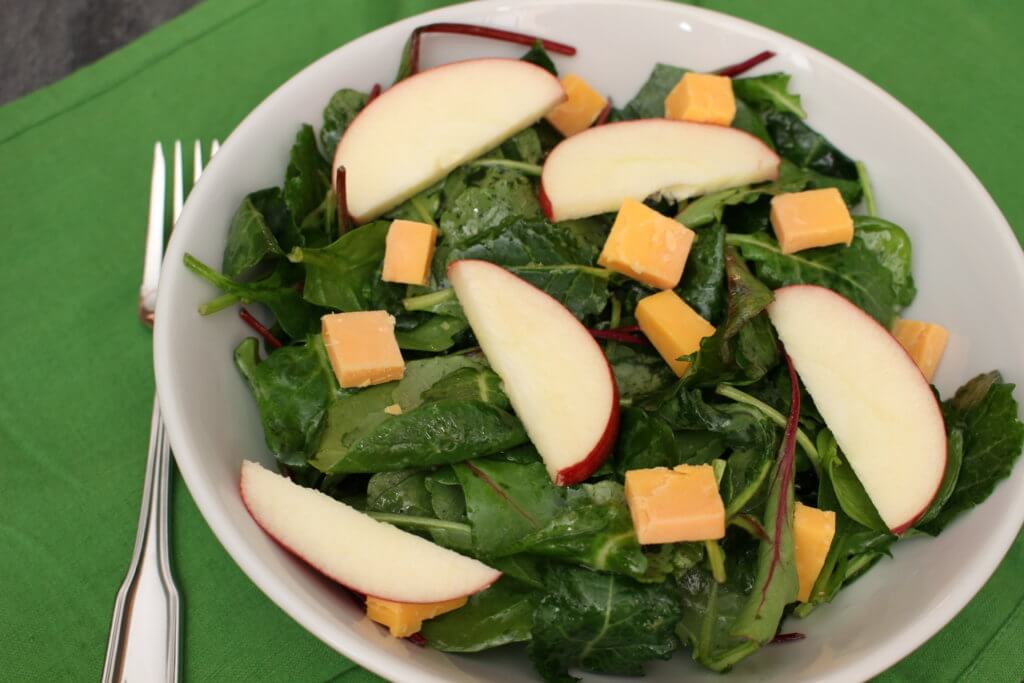 Kale salad gets a sweet and savory makeover with apples and cheddar cheese. A simple side dish or main paired alongside grilled chicken.