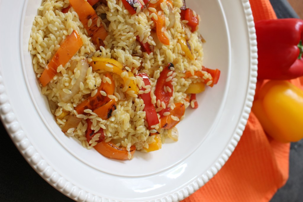 Orzo salad with bell peppers and garlic dressing is the perfect side dish for any summer BBQ or weeknight meal. Fresh bell peppers and a store bought dressing pack a punch of flavor!