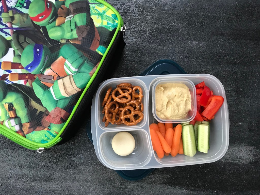 Pack your favorite flavored hummus + crunchy veggies for a healthy school hummus lunchbox.