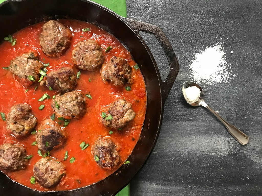 A classic meatball recipe gets a flavor-punch with extra Parmesan cheese in these easy baked Parmesan meatballs.