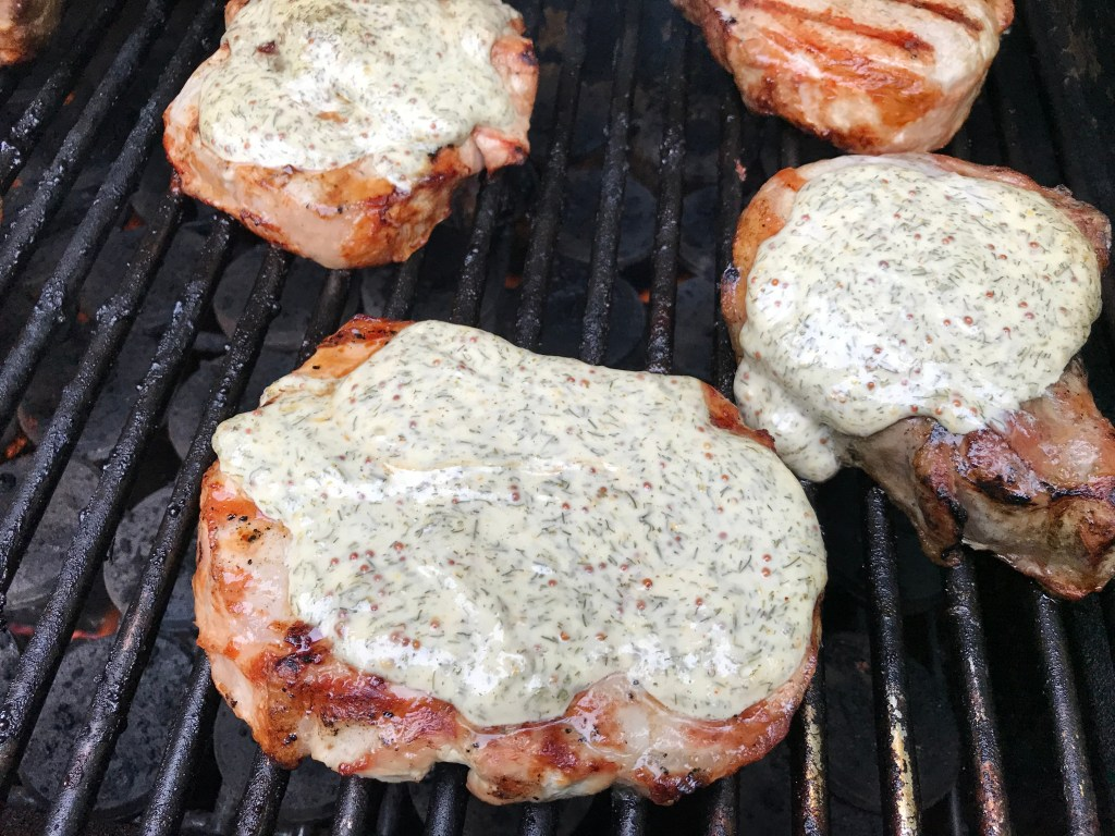 Grilled pork chops with lemony dill sauce make a delicious main for any BBQ or outdoor gathering. Fresh, fast, and simple, the sauce iswhat makes the pork extra moist!