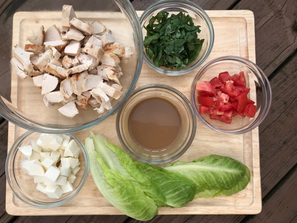 Caprese Chicken Lettuce Wraps have all the components of the classic Caprese salad with extra protein from lean chicken breast and crunch from romaine lettuce leaves. A simple and fresh meal for lunch or dinner.