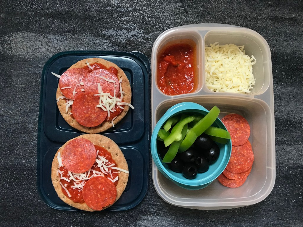 Homemade pizza lunchables bring the best of both worlds to your child's lunchbox: PIZZA and fun! Packed with simple ingredients that are good for you and customizable as well!