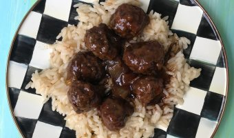 5 Ingredient Slow Cooker Meatballs are simple, saucy, and the ideal kid-friendly dinner. Once you have the meatballs rolled, just let your slow cooker do the work and enjoy in 4 hours!