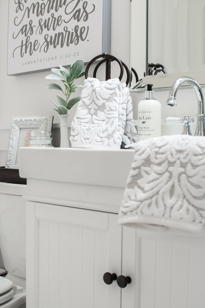 White and Bronze Bathroom Makeover; Farm Sink; Silver faucet with white handles
