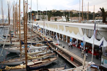Part of the fleet of classic sailboats lined up at the quay with a view of the Monaco Palace @CelinaLafuenteDeLavotha