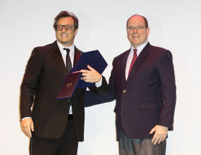 """Prince Albert II of Monaco giving the the Career Award to Gabriele Muccino before the screening of the movie """"Marie et les naufrages"""" held at the Theatres des Varietes Monaco, March 2nd, 2016. Photo by Marco Piovanotto"""