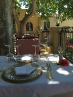 The table is set for lunch under the trees at Villa Gallici@CelinaLafuenteDeLavotha