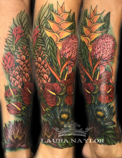 Laura tropical flower leg tattoo.