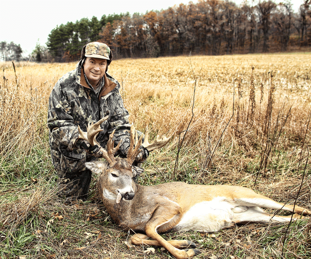 Post-hunt photo of a hunter and his trophy