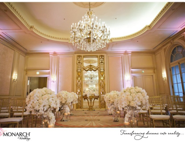 Orchid-rose-centerpieces-lined-ceremony-aisle-westgate-hotel-crystal-chandelier