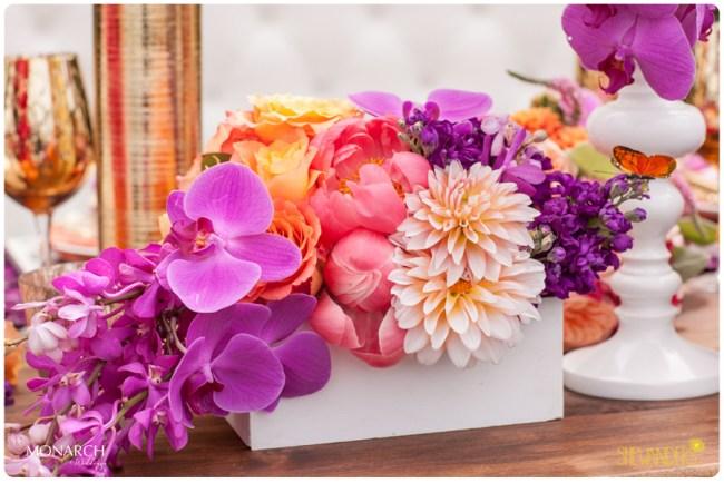 Purple-Phalaenopsis-dahlia-coral-peony-arrangement-exquisite-weddings