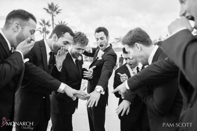 Groomsmen-reaction-to-Groom-wedding-band-ceremony-hotel-del-coronado-wedding