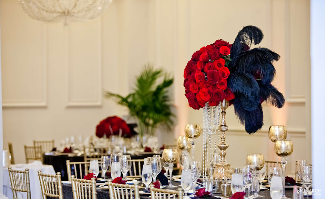 Gatsby-wedding-red-roses-black-feather-centerpiece-gold-accents-us-grant-hotel