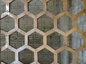 A hexagonal mesh gate in the mausoleum at Uzgen