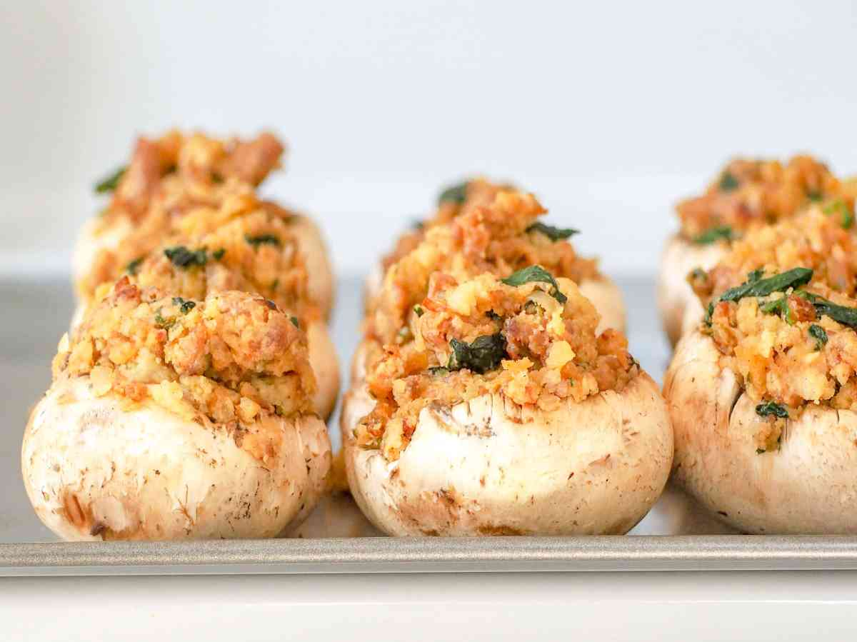 italian sausage stuffed mushrooms on a baking sheet