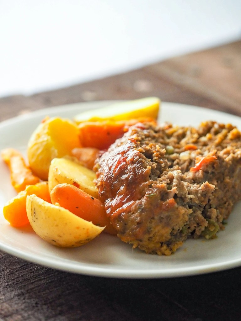 meatloaf dinner on a white plate on table