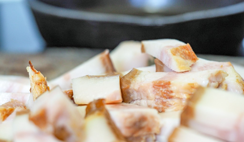 diced jowl bacon on wooden cutting board