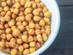 overhead close-up shot of air fried chickpeas in a white bowl on a rustic table